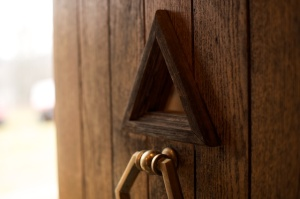 Pyramid window and door knocker. Photo by Phil Franta.